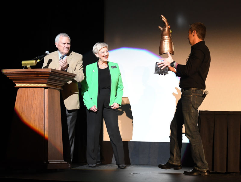 "Georgia Governor Nathan Deal, with wife Sandra Deal, receives the Infinity Gauntlet from Mitch Bell on April 26, 2018 in Atlanta, Georgia. It is not known if he used the gauntlet to apply the veto stamp to Senate Bill 315, which would have criminalized some security research while allowing companies to ""hack back."""