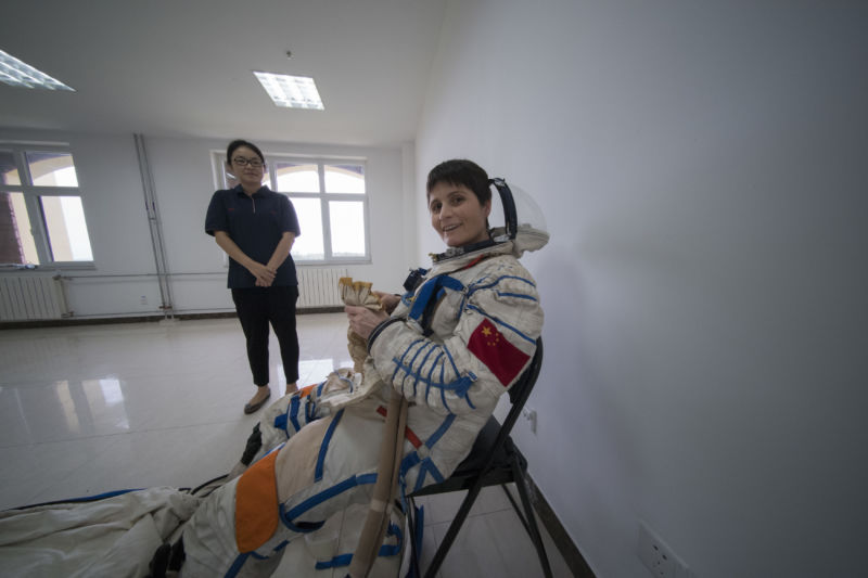 ESA astronaut Samantha Cristoforetti in a Chinese pressure suit during training with Chinese colleagues to practice sea survival off China's coastal city of Yantai, on August 14, 2017.
