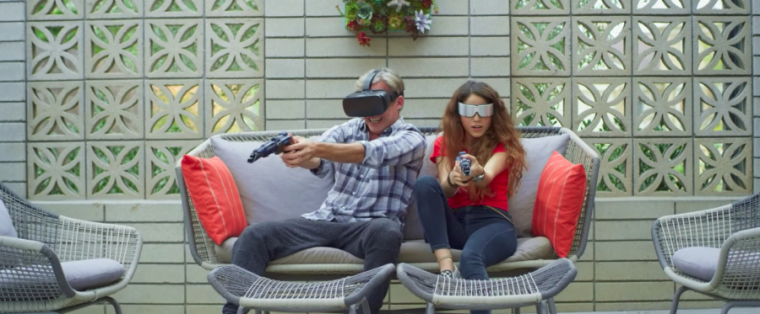 A couple plays with VR on a wicker sofa.