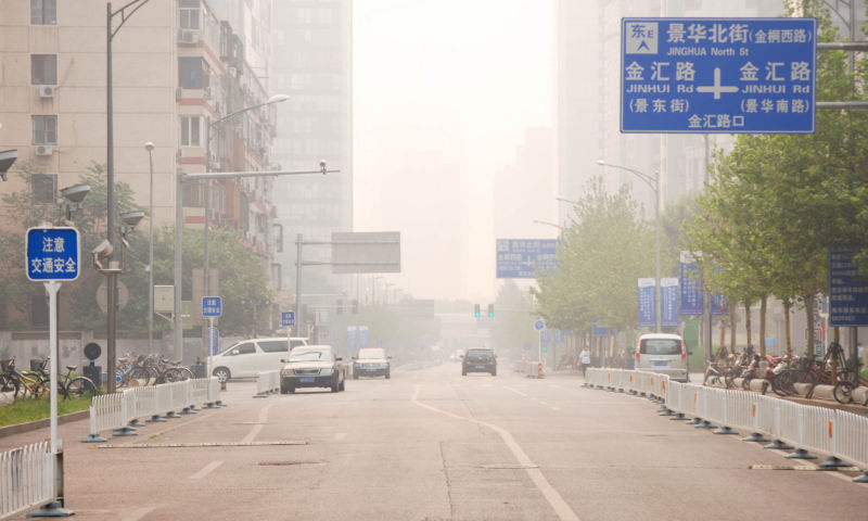 Image of a smog-filled street in downtown Beijing.