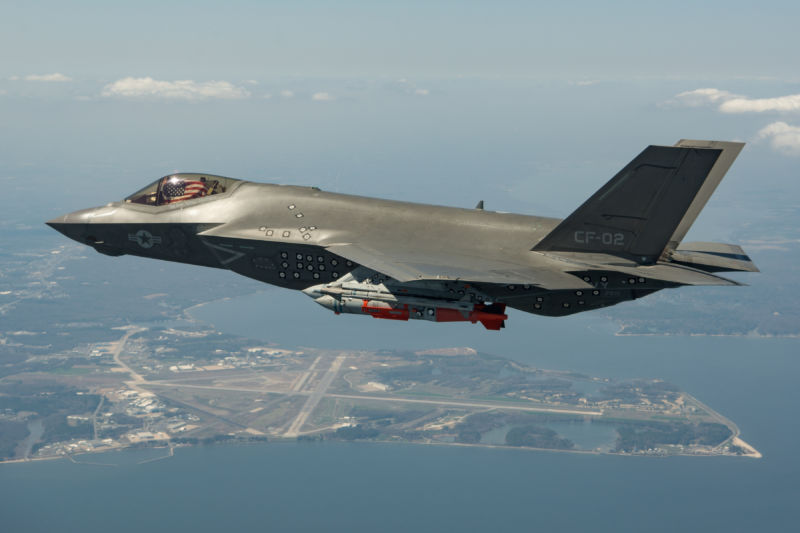 "Lt Cmdr Chris Tabert, Air Test and Evaluation Squadron (VX) 23, pilots Navy F-35C test aircraft CF-02 on Flt 595 for an external GBU-31 flutter and Flying Qualities test flight from Naval Air Station Patuxent River, Maryland, April 10, 2018. Congress is concerned that the F-35 doesn't have the range to attack ""contested"" targets without putting carriers in danger."