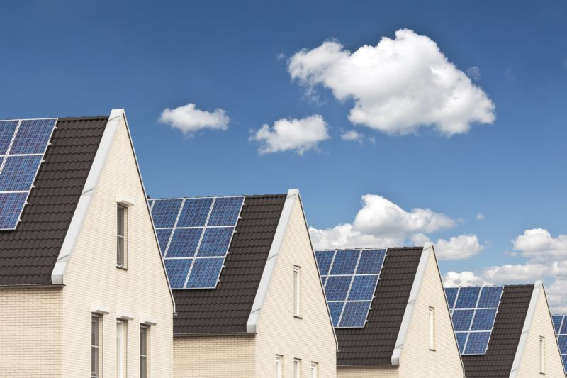 Image shows solar panels on rooftops