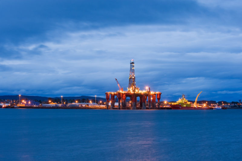 Beautifully-lit offshore oil platform at night.