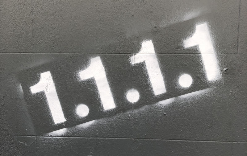A wall spray painted with the text,
