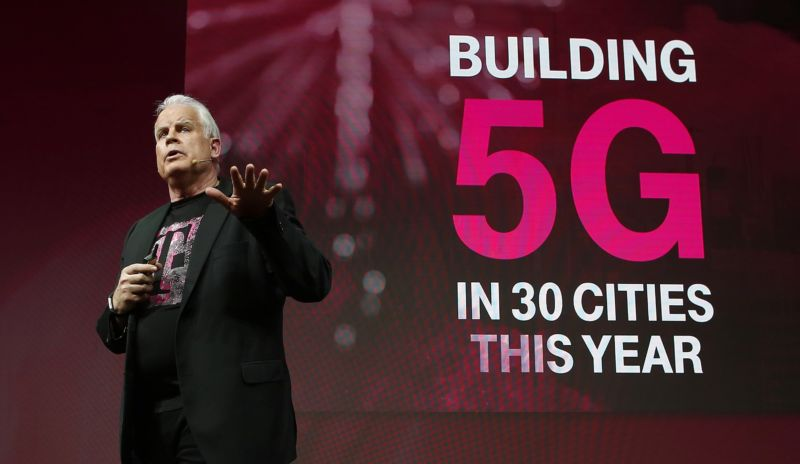 T-Mobile CTO Neville Ray speaking to an audience in front of a slide that says,