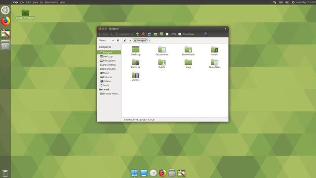 Ubuntu MATE's Mutiny theme with extra dock and Global Menu enabled.