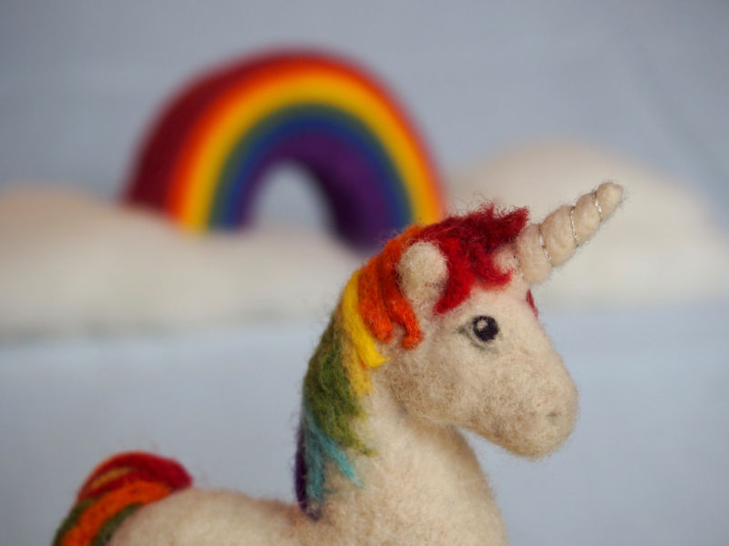 Unicorn with a rainbow in the background