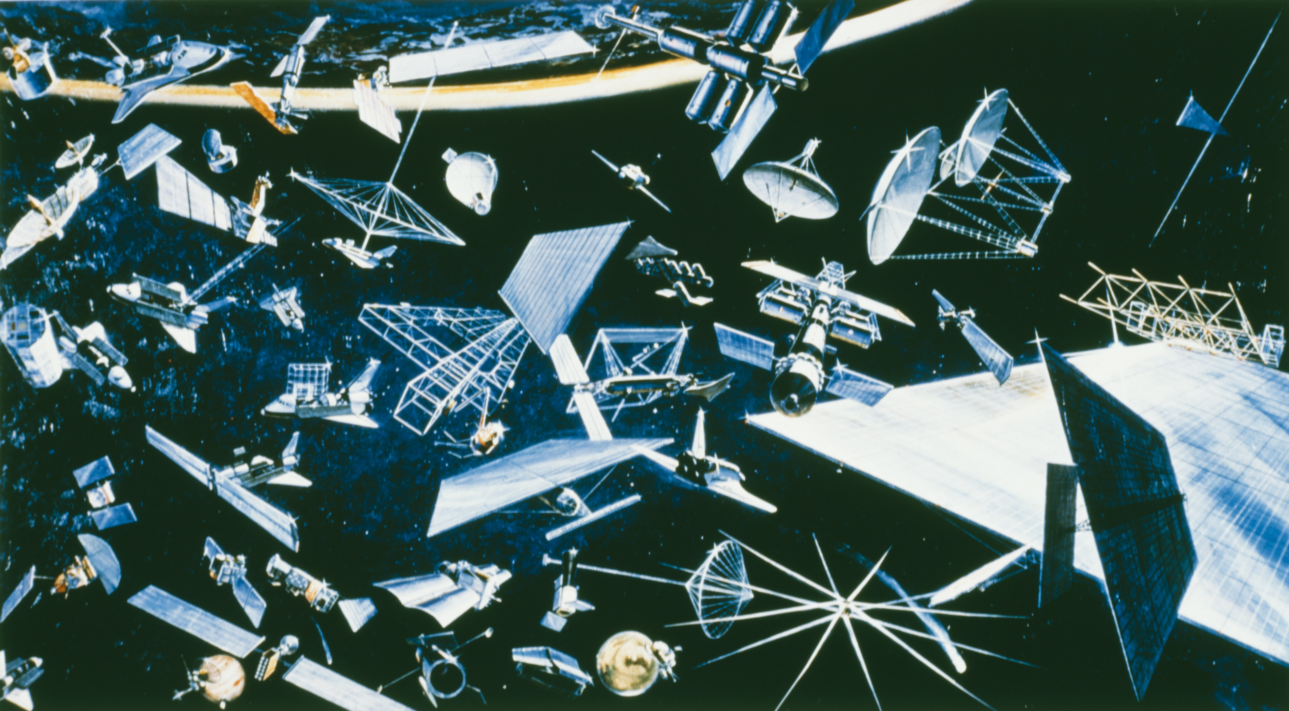 Artist's impression depicting a wide variety of existing and future satellites for communication, surveying Earth resources, and mapping them, circa 1978.