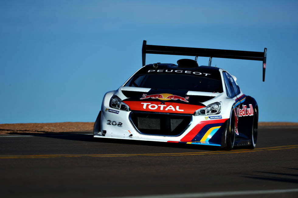 Sebastien Loeb drives the Peugeot 208 T16 at Pikes Peak in 2013.