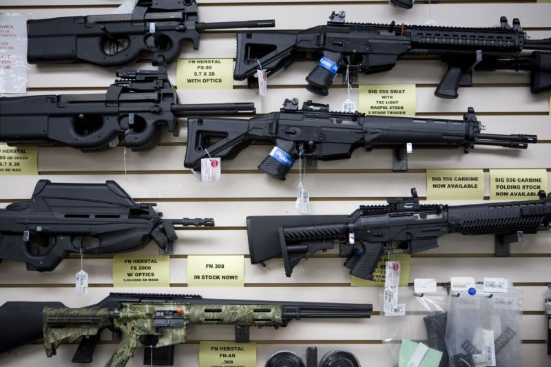Semi-automatic weapons for sale hang on a wall for display at a Texas gun shop.