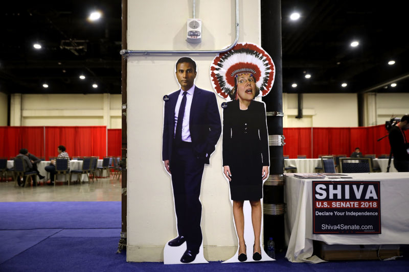 Cardboard cutouts of two politicians, one dashing, one borderline racist