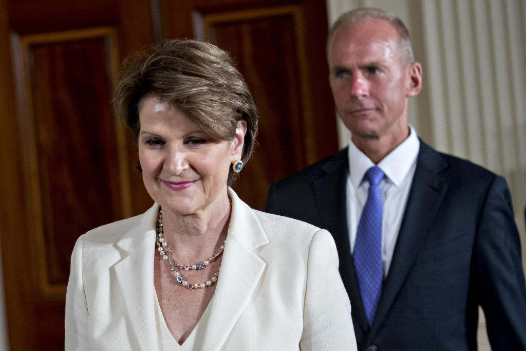 Marillyn Hewson, president and chief executive officer of Lockheed Martin Corp., left, and Dennis Muilenburg, chairman and chief executive officer of Boeing Co., attend a National Space Council meeting on Monday.