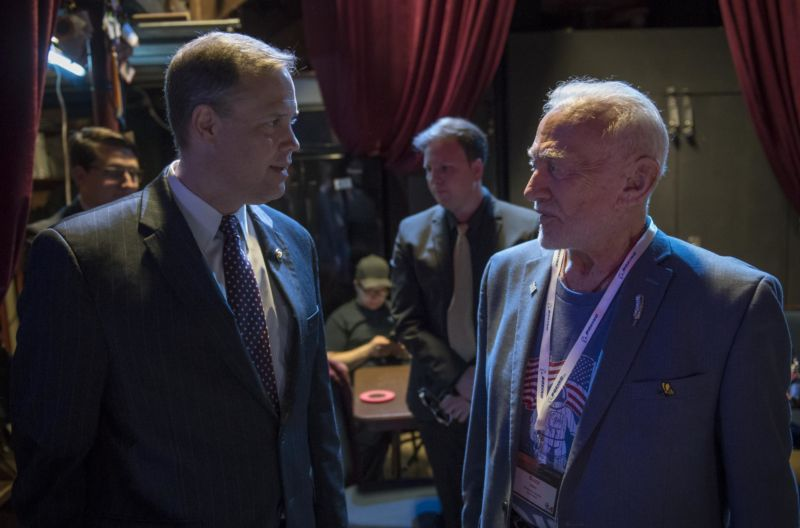 NASA Administrator Jim Bridenstine, left, meets backstage with former NASA astronaut Buzz Aldrin, prior to giving the keynote speech at the Humans to Mars Summit in May 2018 at George Washington University in Washington.