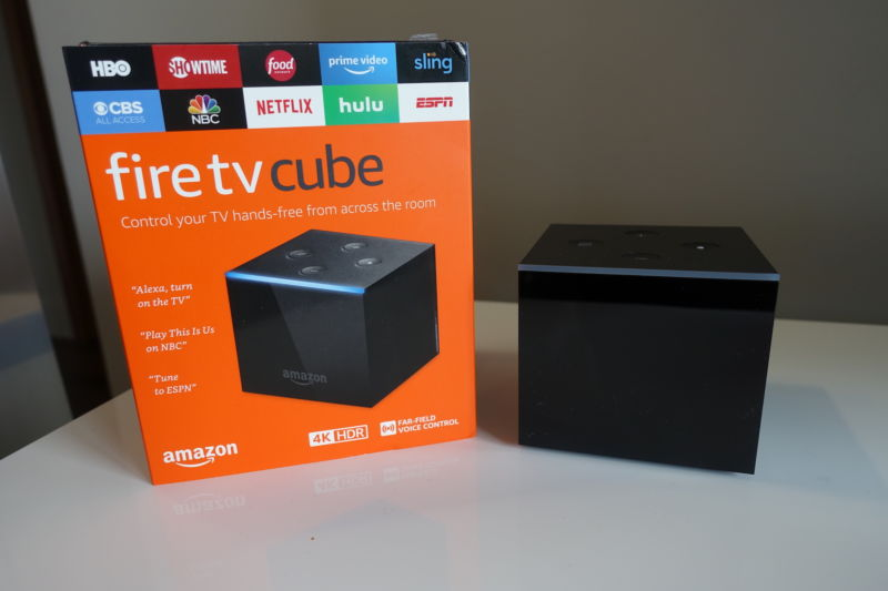 The Fire TV Cube is a small Fire TV with an Echo Dot baked into it. It has a shiny black finish around the sides, with a matte black top.
