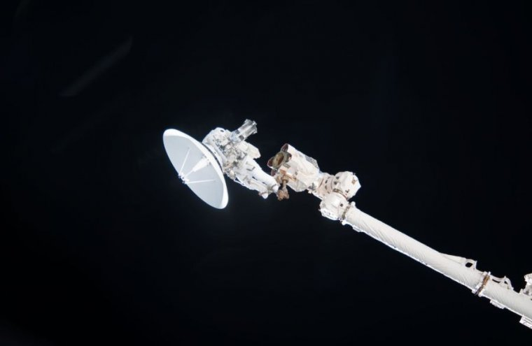 Anchored to a Canadarm2, NASA astronaut Garrett Reisman participates in the mission's first EVA in 2010.