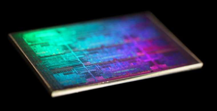 Extreme close-up photograph of computer chip against a black background.