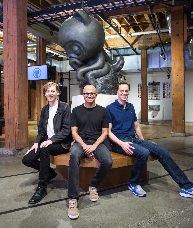 Men in artificially casual Silicon Valley garb pose for a picture.