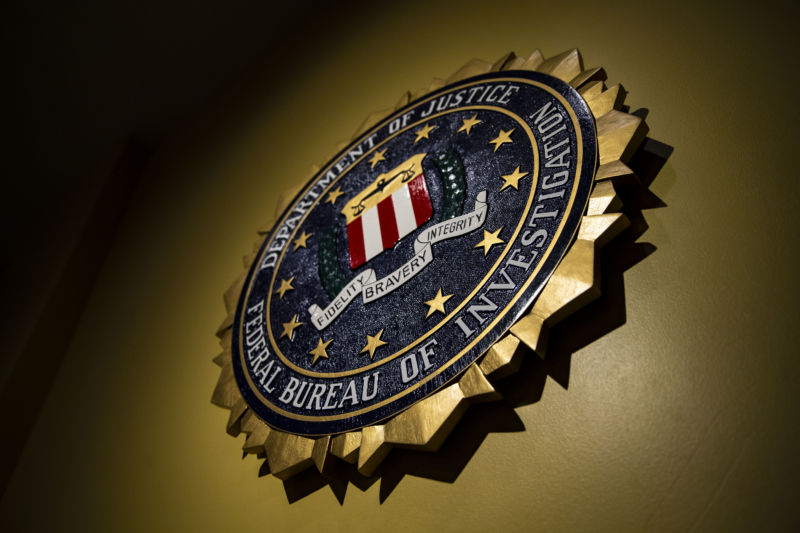 FBI seal hangs on a wall.