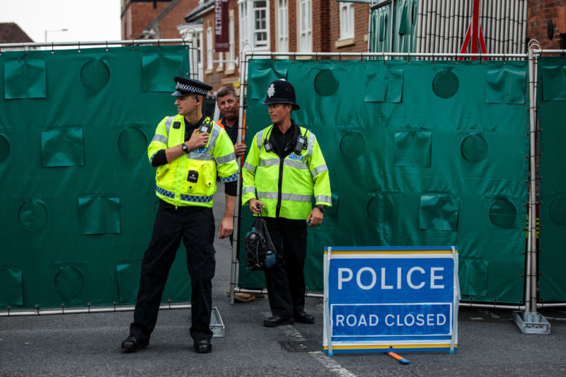 Police officers stand at a cordon around a supported housing project in Salisbury after a major incident was declared when a man and woman were exposed to the Novichok nerve agent.