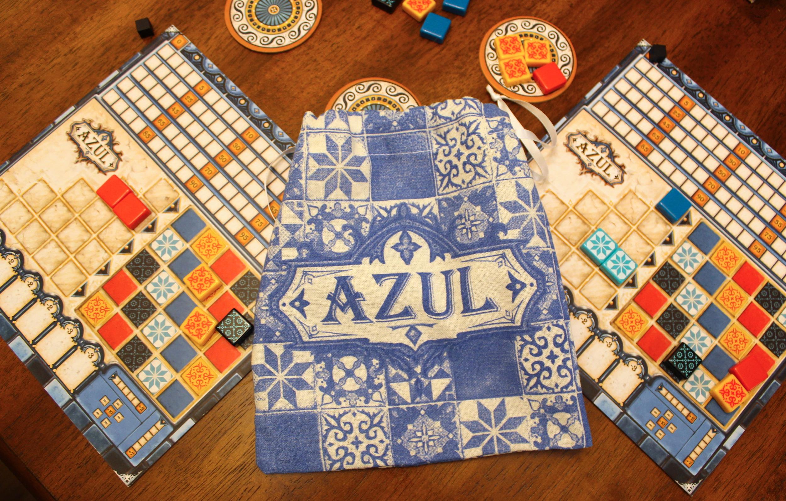 <em>Azul</em> even comes with its own custom-printed bag.