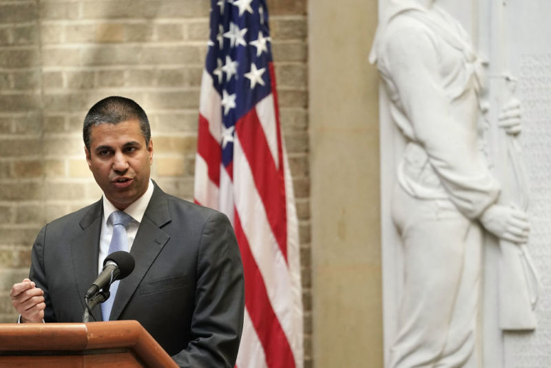 FCC Chairman Ajit Pai speaking in front of an American flag.