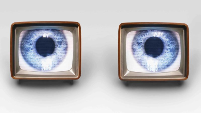 Two TV sets, with each showing a picture of an eye.