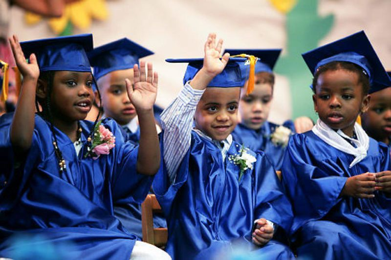 Image of children at a graduation ceremony.