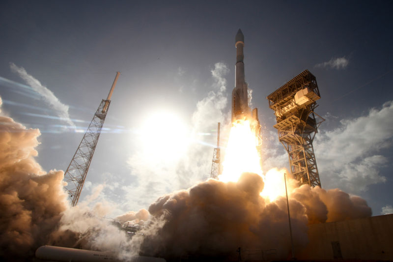 An Atlas V rocket lifts off in 2016, powered by a single RD-180 engine and solid rocket boosters.