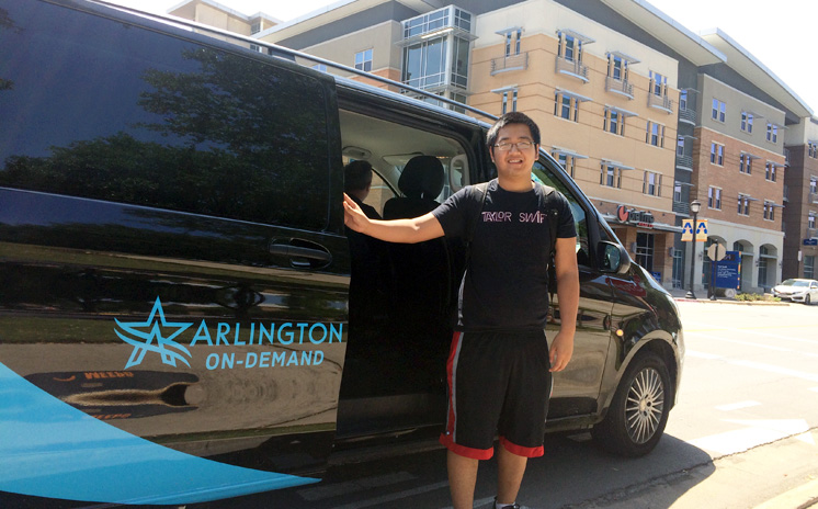 Marvin Tran, a student at the University of Texas, Arlington, takes a city-subsidized Via shuttle to get to school.