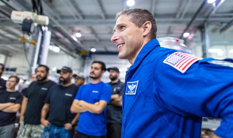 NASA astronaut Mike Hopkins meets with employees at SpaceX on Monday.
