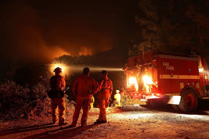 Cal Fire firefighters monitor a back fire while battling the Medocino Complex fire on August 7, 2018 near Lodoga, California.