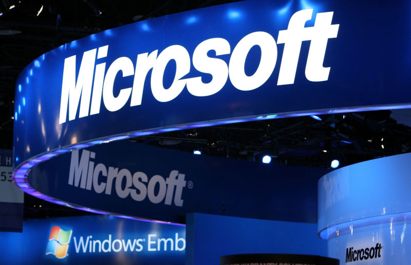 The Microsoft logo is displayed at the Microsoft booth at a trade show