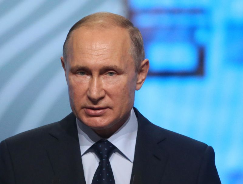 Russian President Vladimir Putin speaking at a forum.