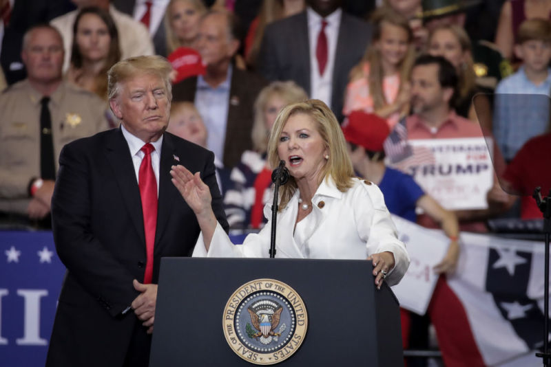 Rep. Marsha Blackburn (R-Tenn.) speaks to a crowd at a campaign rally as President Donald Trump looks on.