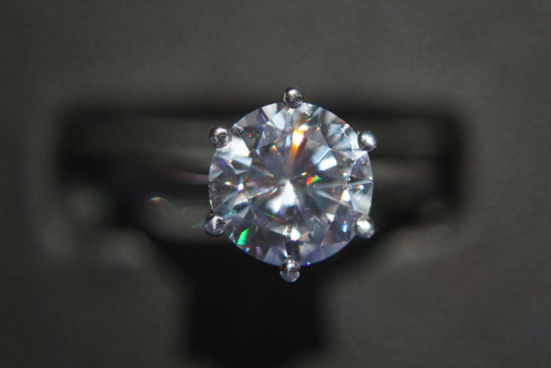 Close up of a diamond mounted on a ring.