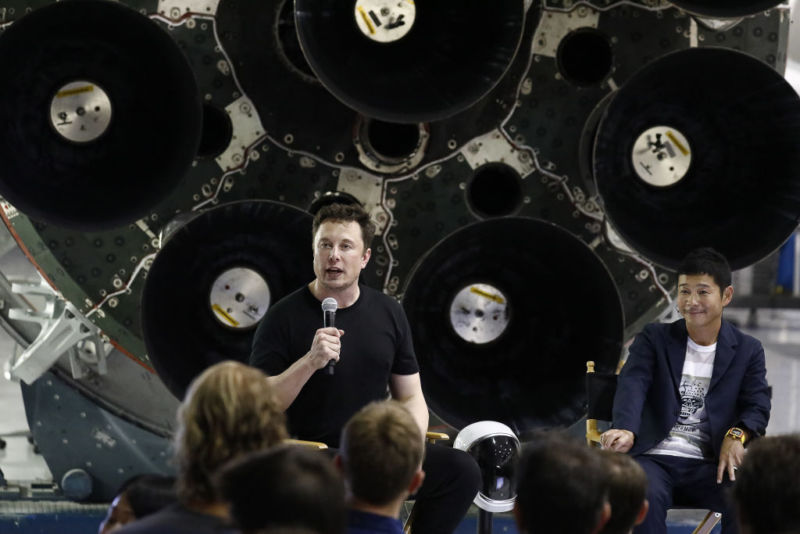 Elon Musk speaks as Yusaku Maezawa, founder and president of Start Today Co., looks on at an event at the SpaceX headquarters in Hawthorne, California, on Monday,