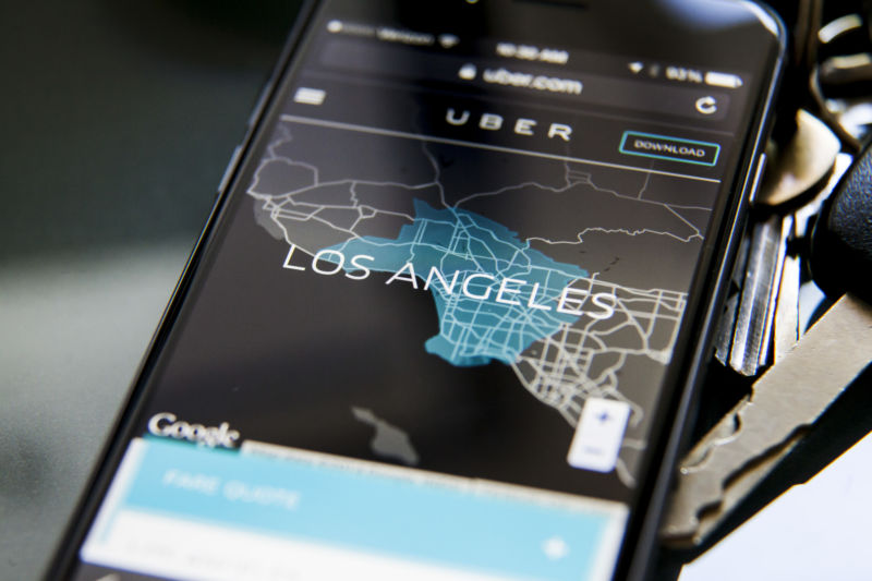 Close-up image of a smartphone using Uber app.