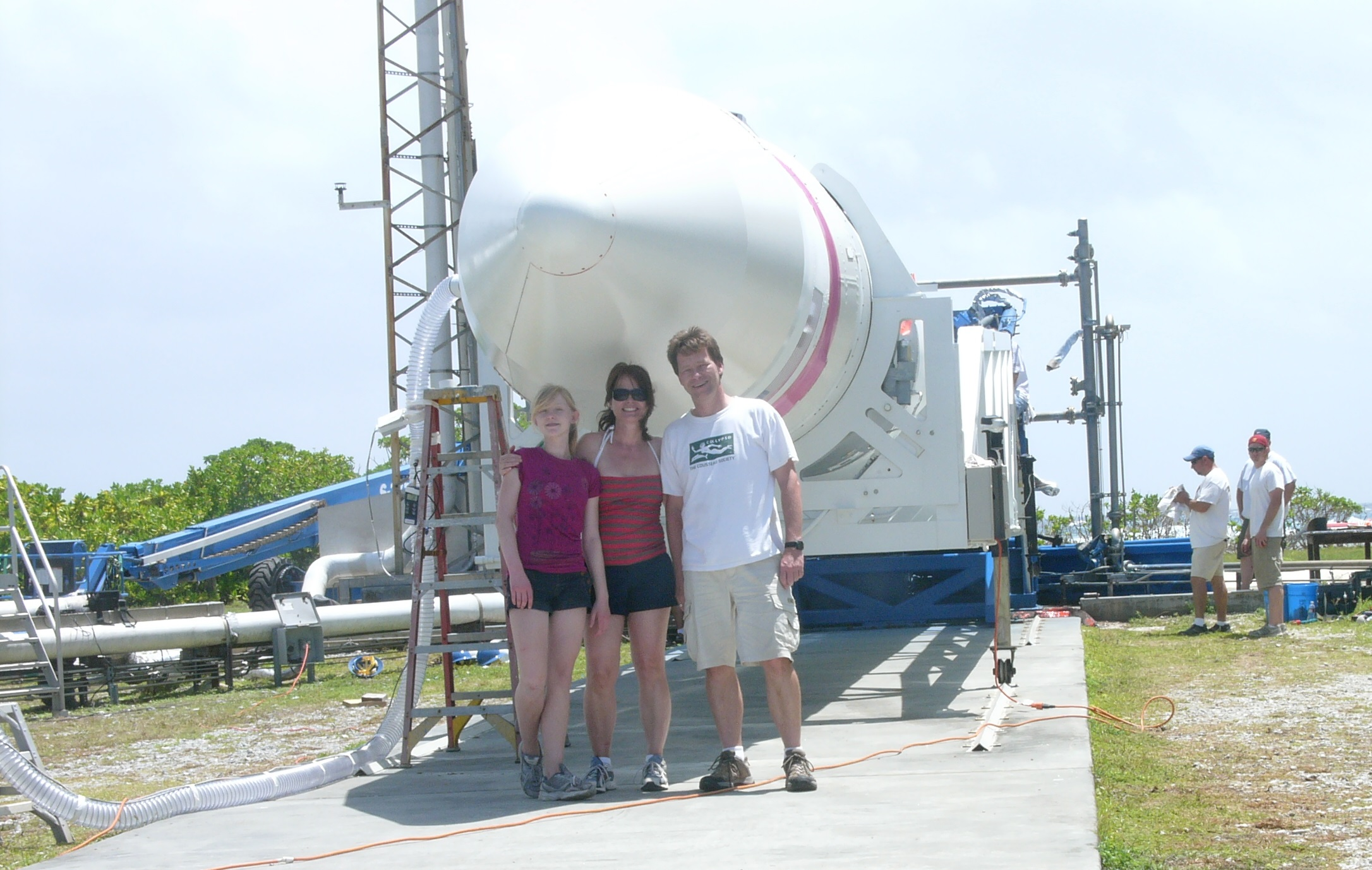 Hans Koenigsmann with his family, and the Falcon 1 rocket, at Omelek.