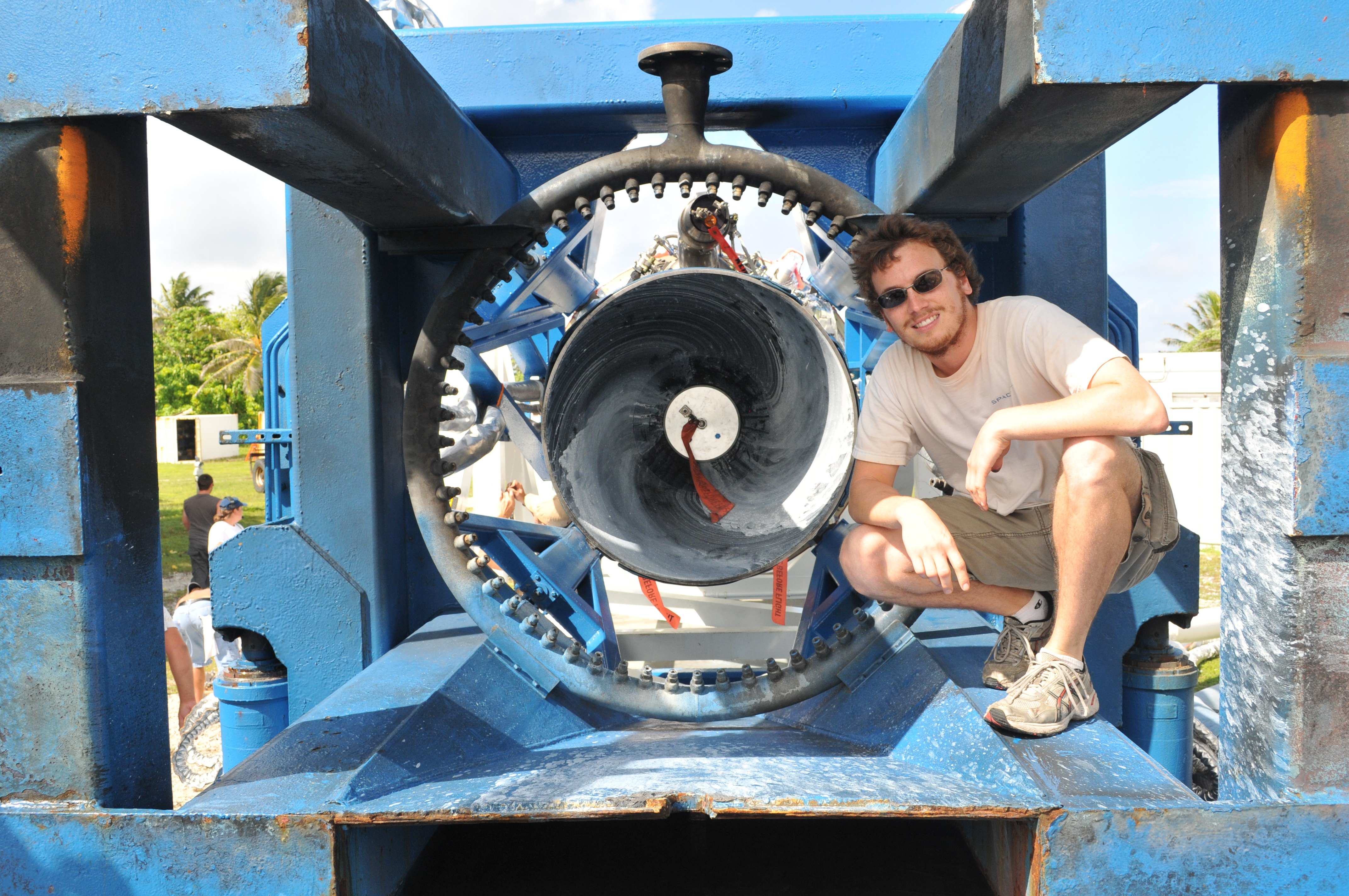 Zach Dunn with the Merlin engine that powered the successful fourth flight of the Falcon 1 rocket.