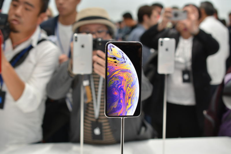 Smartphones on display at a crowded convention.