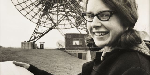 A young Jocelyn Bell with the radio telescope array she helped build at Cambridge.