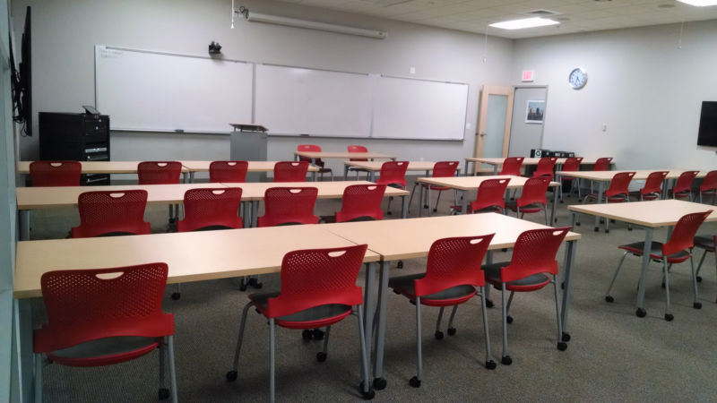 Empty classroom with whiteboards.
