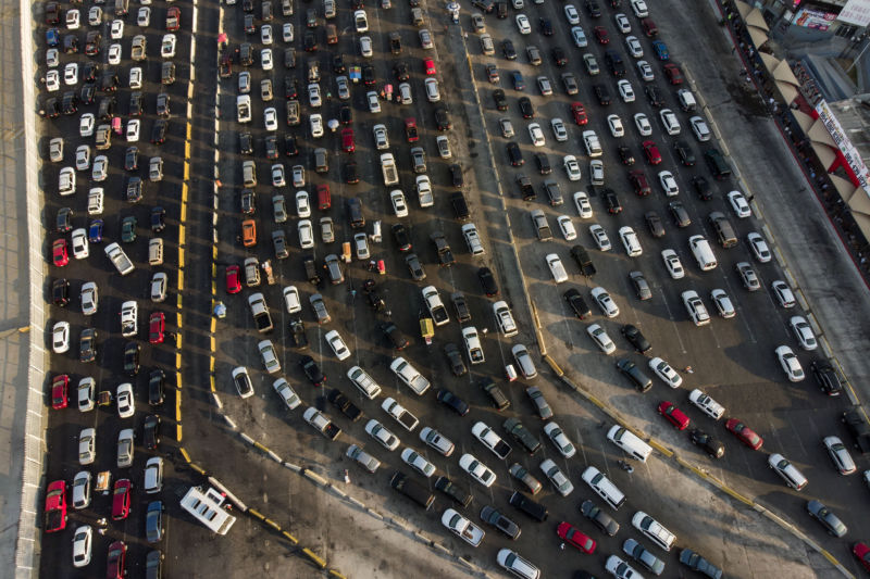 Aerial view of vehicles lining up to cross to the United States at San Ysidro Port of Entry as seen from Tijuana, Baja California state, Mexico on August 10, 2018.