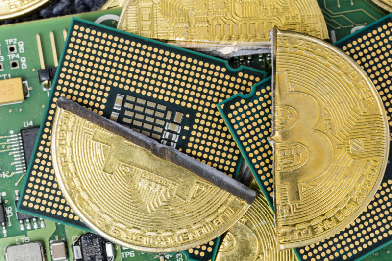 Stylized, composite image of bitcoins against motherboards.