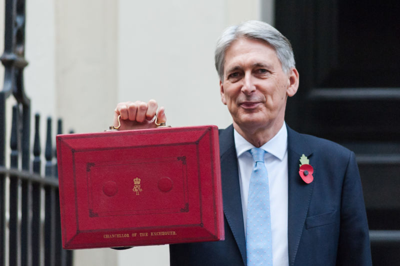 LONDON - Chancellor of the Exchequer Philip Hammond poses with the budget box at 11 Downing Street before the announcement of the Autumn Budget Statement in the House of Commons on October 29, 2018.