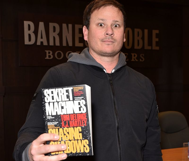 "Tom DeLonge with one of his new novels about ""The Phenomenon."""