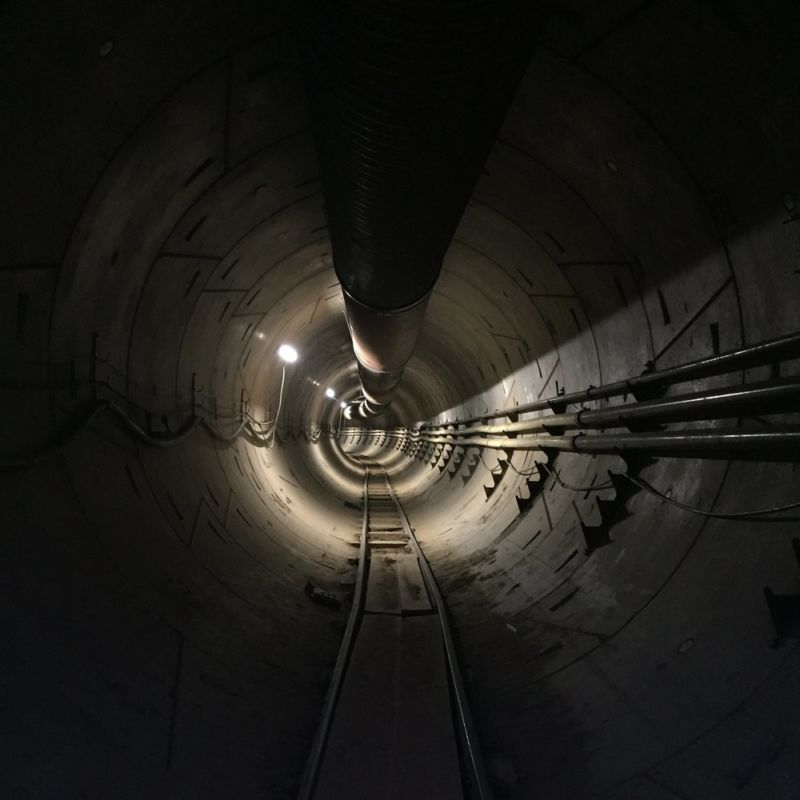 Dimly lit tunnel with piping