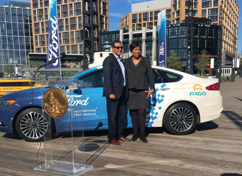 Sherif Marakby, CEO of Ford's autonomous vehicle subsidiary, poses with DC Mayor Muriel Bowser.
