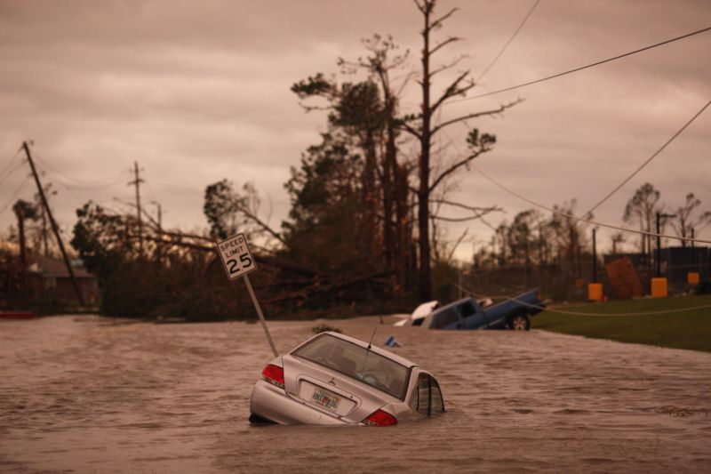 Vehicles sit partially submerged in floodwaters after Hurricane Michael hit in Panama City, Florida, U.S., on Wednesday, Oct. 10, 2018.