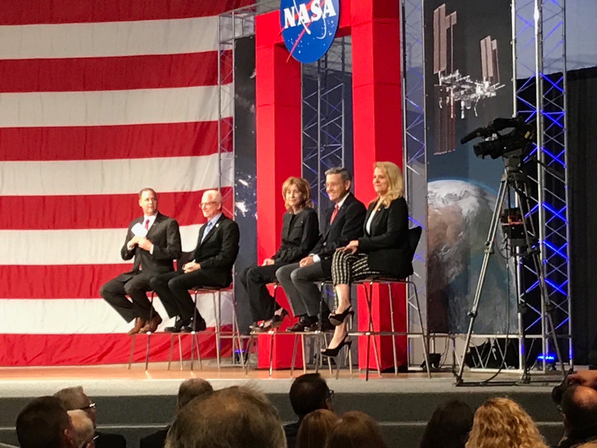 Caret, center, and Shotwell, far right, at Johnson Space Center in August.